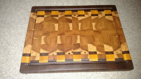 "Cutting Board 16 - End 025. 15"" x 19-1/2"" x 1-1/2"". End grain, Juice groove. Black Walnut, Yellowheart & Hickory."